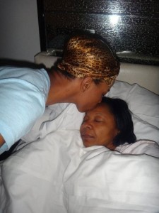 Brandee kisses her mother goodnight.
